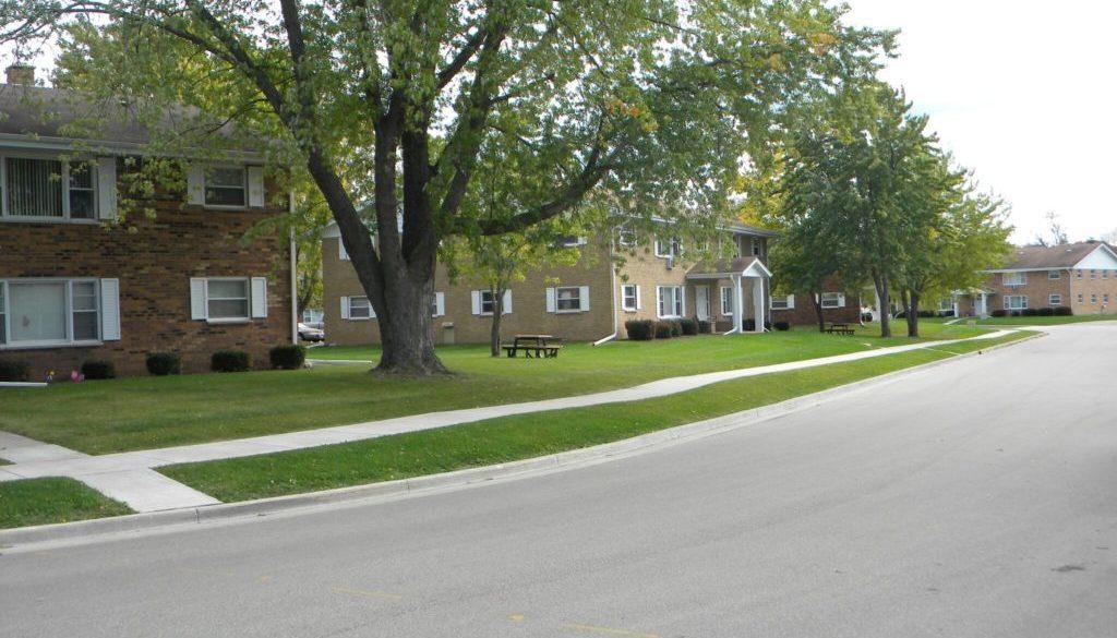 Encore Real Estate Brokerage- Slinger Apartments